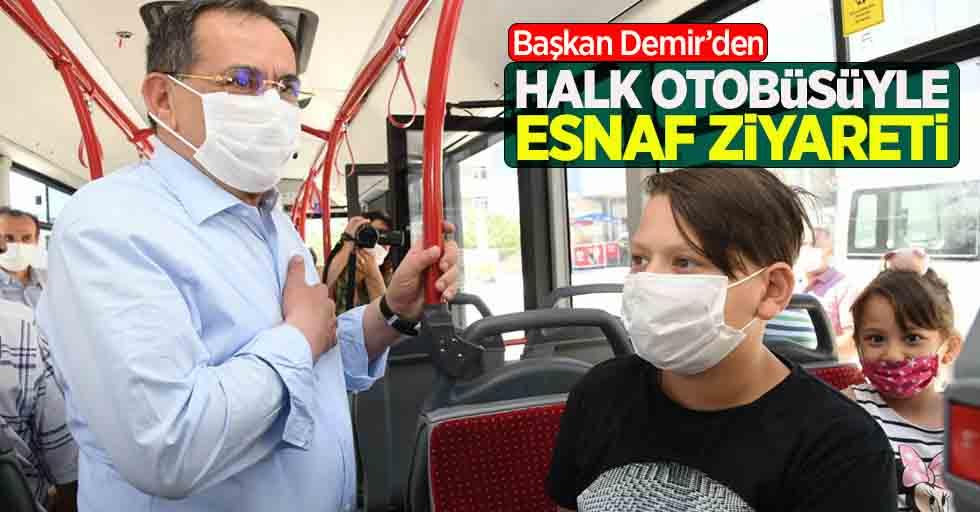 Başkan Demir'den halk otobüsüyle esnaf ziyareti
