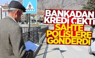 Bankadan çektiği krediyi sahte polislere verdi