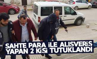 Sahte para ile alışveriş yapan 2 kişi tutuklandı