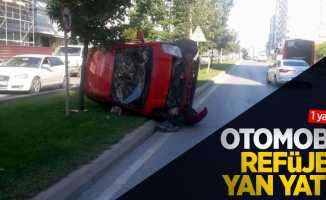 Otomobil refüje yan yattı: 1 yaralı