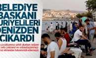 Belediye başkanı Suriyelileri denizden çıkardı